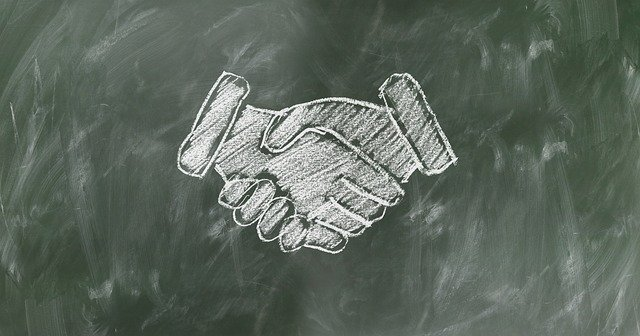 shaking hands customer loyalty